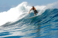 photo shows positive image of a surfer - surfing life's trials and tribulations such as redundancy
